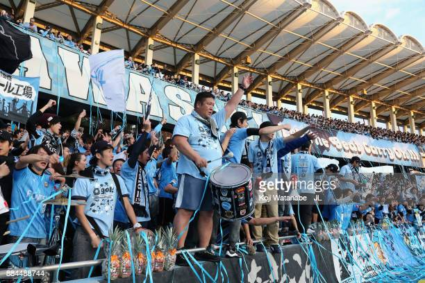 Kawasaki Frontale supporters celebrate their team's JLeague Champions for the first time after the JLeague J1 match between Kawasaki Frontale and...
