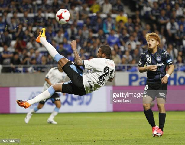 Kawasaki Frontale's Eduardo Neto clears the ball during the second half of a JLeague first division match against Gamba Osaka at Suita Stadium in...