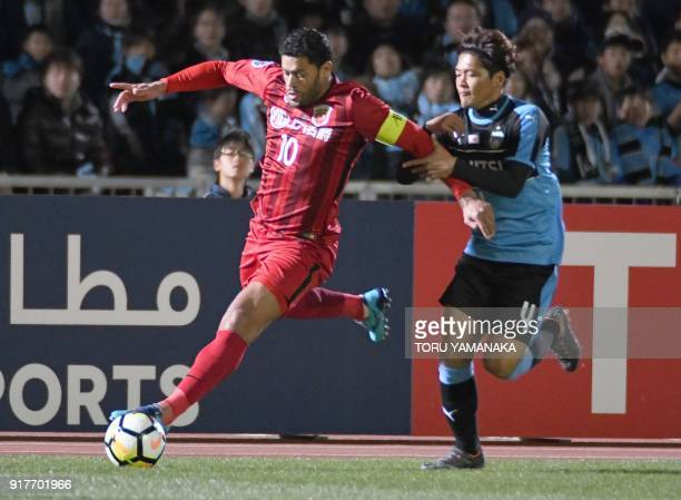 Kawasaki Frontale's forward Yoshito Okubo fights for the ball with Shanghai SIPG's forward Hulk during the AFC Champions League group F football...