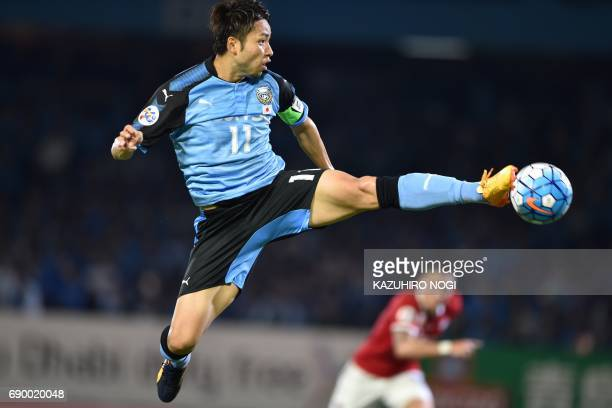 Kawasaki Frontale's forward Yu Kobayashi attempts a shot during their AFC Champions League round of 16 second leg football match between Japan's...