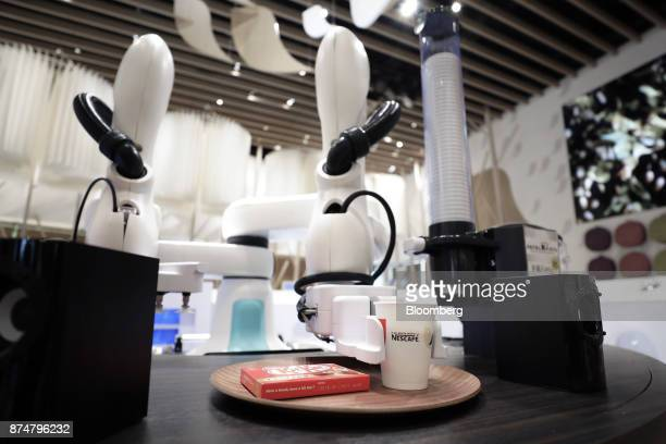 A Kawasaki Heavy Industries Ltd dualarm SCARA robot known as 'duAro' serves a cup of coffee during a media preview of the humanless cafe at the...