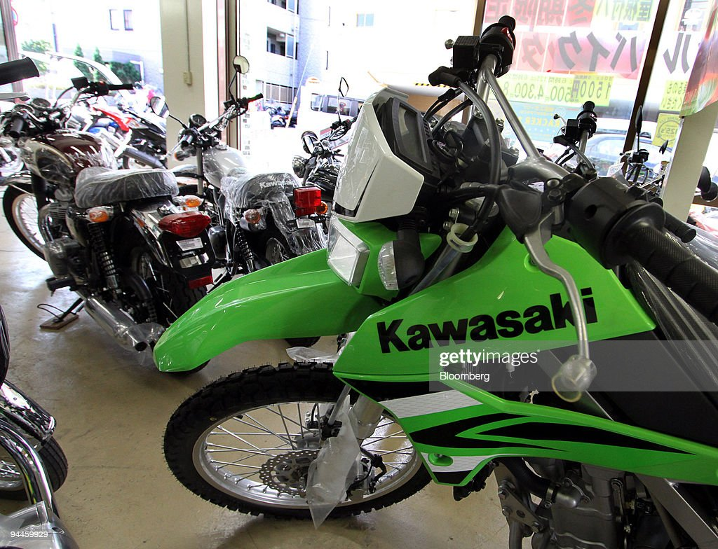 Kawasaki Heavy Industries Ltd. motorcycles are displayed at a dealership in Tokyo, Japan, on Saturday, Dec. 12, 2009. Kawasaki Heavy Industries Ltd., a Japanese maker of motorcycles and trains, aims to break even in its consumer products business next fiscal year by cutting costs, Senior Vice President Hiroshi Takata said. Photographer: Haruyoshi Yamaguchi/Bloomberg via Getty Images