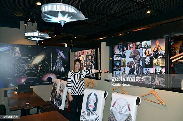 """Kawasaki, Japan - A Japanese-style """"izakaya"""" pub featuring monsters and aliens from Japan's iconic Ultraman superhero comic series is shown to the..."""