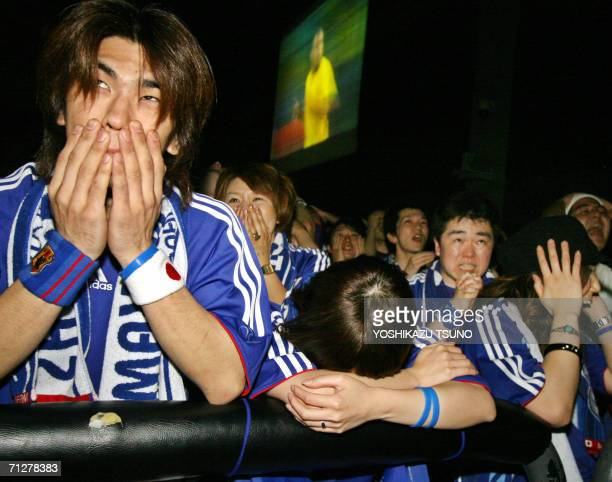 Disapointed Japanese football fans react to Brazil's Ronald scoring a goal during a public viewing of the live broadcasting of the FIFA World Cup...