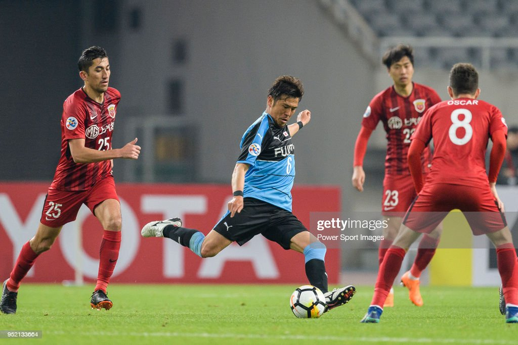 Kawasaki Midfielder Tasaka Yusuke (C) attempts a kick during the AFC Champions League 2018 Group Stage F Match Day 5 between Shanghai SIPG and Kawasaki Frontale at Shanghai Stadium on 04 April 2018 in Shanghai, China.
