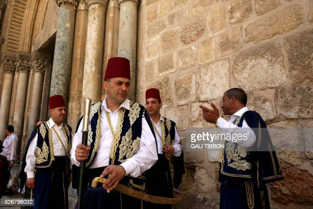 Kawases of the Greek Orthodox patriarchate in traditional Ottoman outfits stand outside the church of the Holy Sepulchre in Jerusalem's Old City...