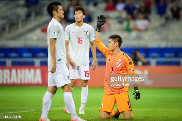 Kawashima of Japan contests the referee decision during the Copa America Brazil 2019 group C match between Ecuador and Japan at Mineirao Stadium on...