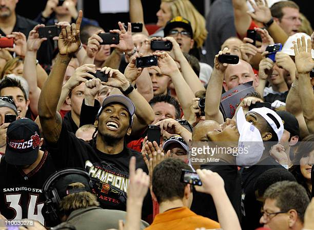 Kawhi Leonard and Billy White of the San Diego State Aztecs celebrate with fans after the team's 7254 victory over the Brigham Young University...