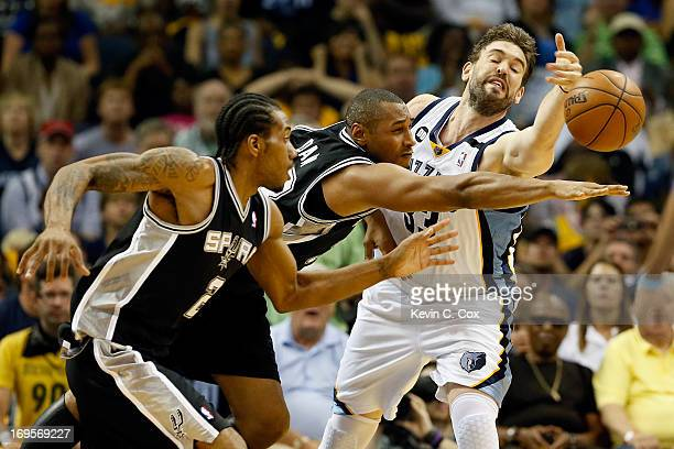 Kawhi Leonard and Boris Diaw of the San Antonio Spurs go after the ball against Marc Gasol of the Memphis Grizzlies in the second quarter during Game...