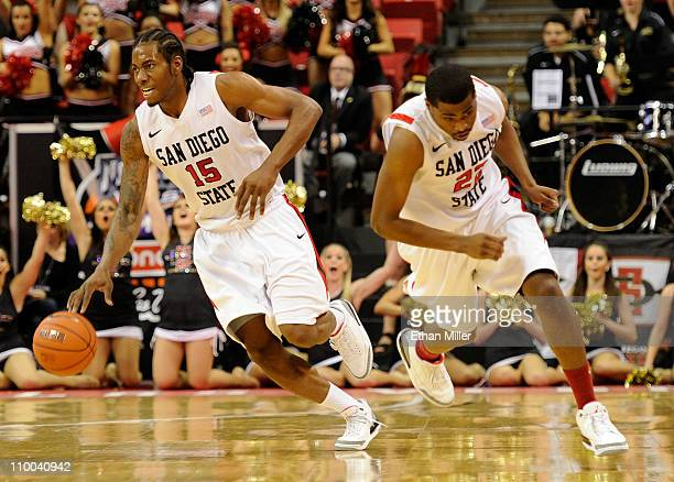 Kawhi Leonard and Chase Tapley of the San Diego State Aztecs start a fast break during a quarterfinal game of the Conoco Mountain West Conference...