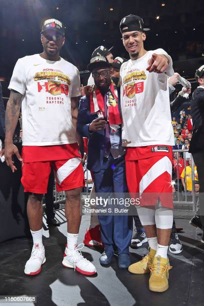 Kawhi Leonard and Danny Green of the Toronto Raptors react onstage after defeating the Golden State Warriors in Game Six of the 2019 NBA Finals on...