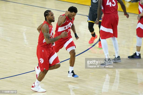 Kawhi Leonard and Kyle Lowry of the Toronto Raptors celebrate late in the game against the Golden State Warriors during Game Six of the 2019 NBA...
