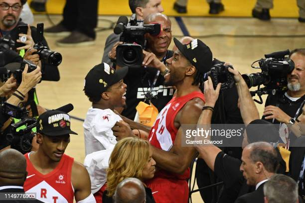 Kawhi Leonard and Kyle Lowry of the Toronto Raptors smile and celebrate on court after winning Game Six of the NBA Finals against the Golden State...