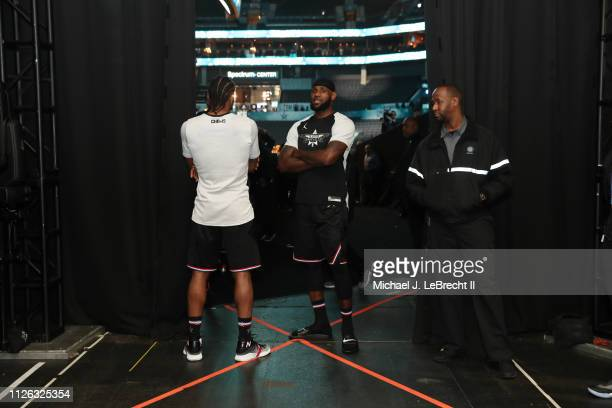 Kawhi Leonard and LeBron James of Team LeBron look on during the 2019 NBA AllStar Game on February 17 2019 at the Spectrum Center in Charlotte North...