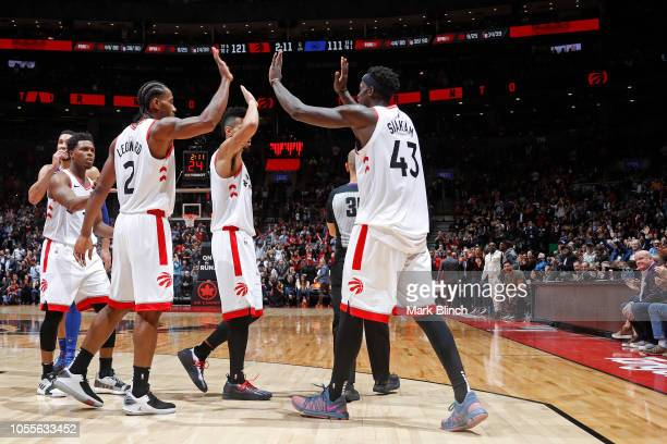 Kawhi Leonard and Pascal Siakam of the Toronto Raptors high five during the game against the Philadelphia 76ers on October 30 2018 at Soctiabank...