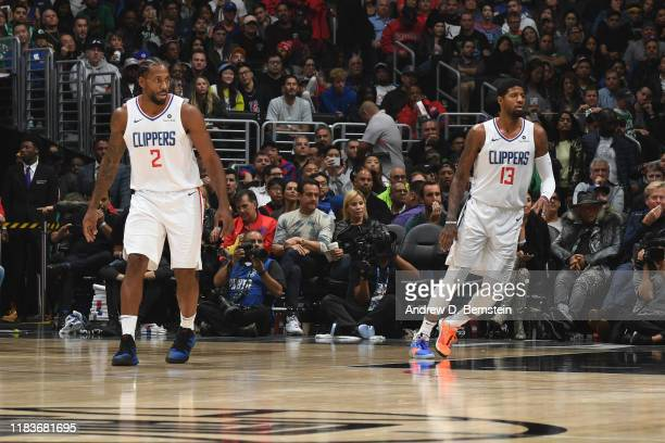 Kawhi Leonard and Paul George of the LA Clippers on guard during the game against the Boston Celtics on November 20 2019 at STAPLES Center in Los...