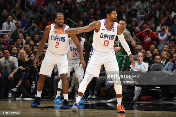 Kawhi Leonard and Paul George of the LA Clippers react to a play against the Boston Celtics on November 20 2019 at STAPLES Center in Los Angeles...