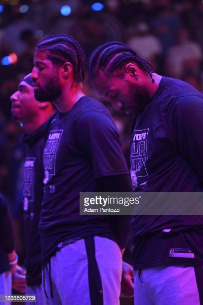 Kawhi Leonard and Paul George of the LA Clippers stand for the national anthem before the game against the Utah Jazz during Round 2, Game 4 of 2021...