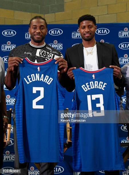 Kawhi Leonard and Paul George pose after a news conference where both players were introduced as new Los Angeles Clippers at Green Meadows Recreation...