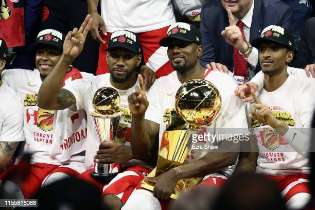 Kawhi Leonard and Serge Ibaka of the Toronto Raptors celebrates their teams victory over the Golden State Warriors in Game Six to win the 2019 NBA...