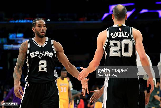 Kawhi Leonard congratulates Manu Ginobili of the San Antonio Spurs after defeating the Los Angeles Lakers 116107 during a game at Staples Center on...