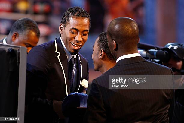 Kawhi Leonard from San Diego State celebrates with his guests in the player's green room after he was selected overall by the Indiana Pacers in the...