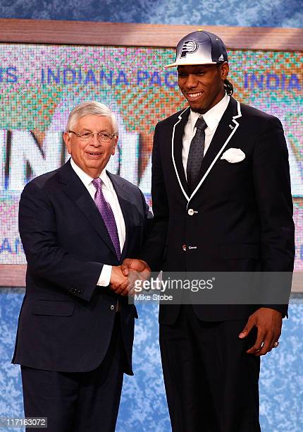 Kawhi Leonard from San Diego State greets NBA Commissioner David Stern after he was selected overall by the Indiana Pacers in the first round during...