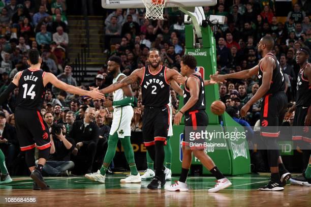 Kawhi Leonard hifives Danny Green Kyle Lowry and Serge Ibaka of the Toronto Raptors on January 16 2019 at the TD Garden in Boston Massachusetts NOTE...