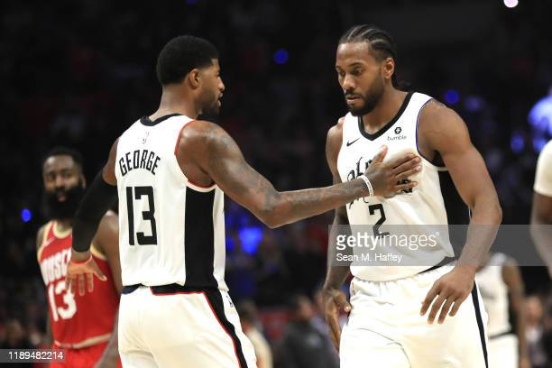 Kawhi Leonard is congratulated by Paul George of the Los Angeles Clippers during the second half of a game against the Houston Rockets at Staples...