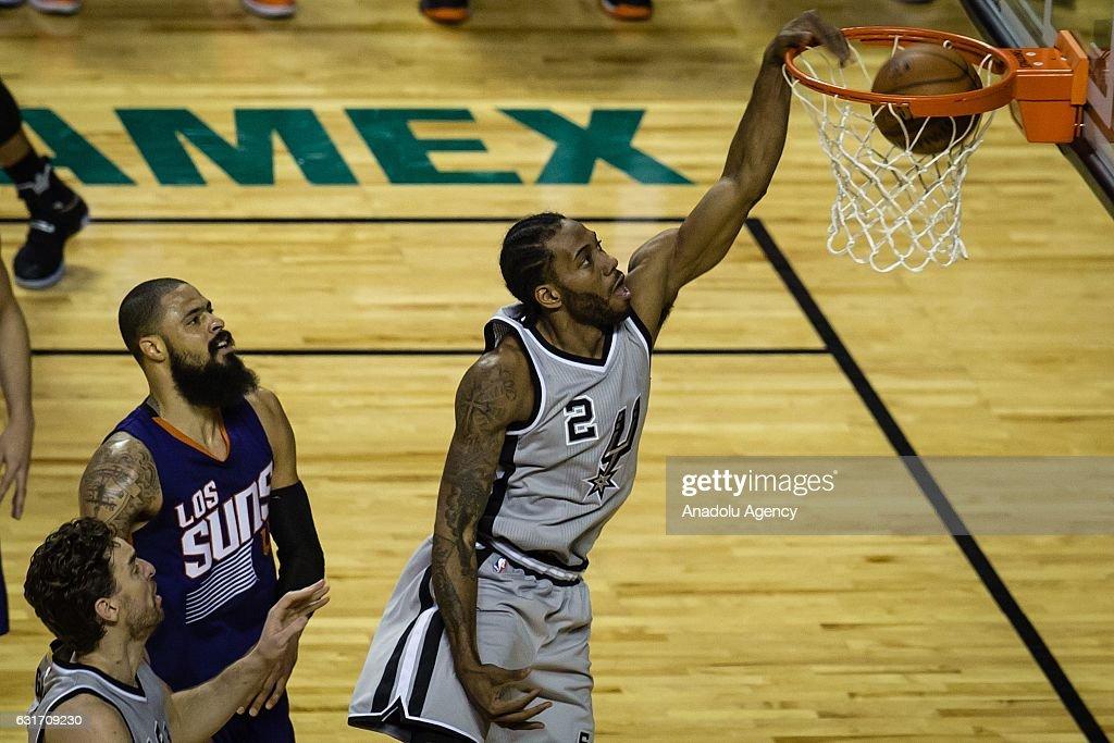 Kawhi Leonard (R) of San Antonio Spurs in action during the NBA Game Mexico City between Phoenix Suns and San Antonio Spurs at Arena Ciudad de Mexico, in Mexico City, Mexico on January 14, 2017.