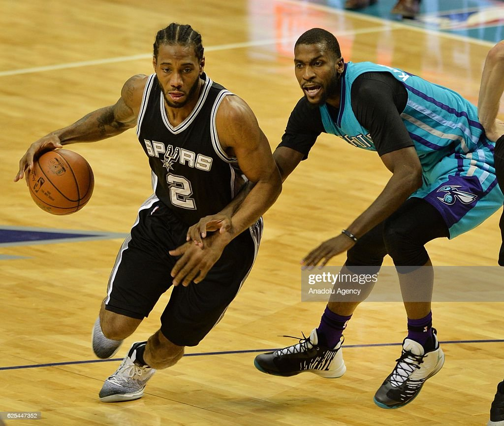 Kawhi Leonard of San Antonio Spurs passing the Charlotte Hornets' defense during the NBA match between San Antonio Spurs vs Charlotte Hornets at the Spectrum arena in Charlotte, NC, USA on November 23, 2016.