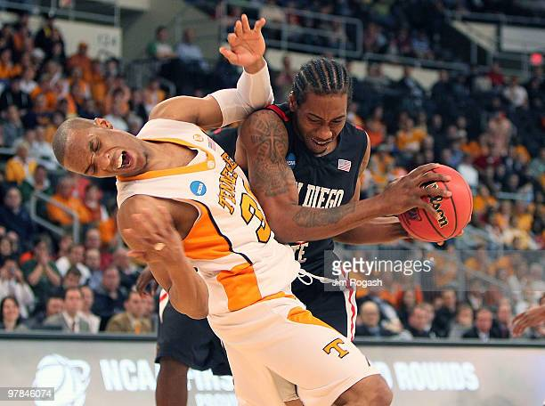 Kawhi Leonard of San Diego State Aztecs collides with J.P. Prince of Tennessee Volunteers during the first round of the 2010 NCAA men's basketball...