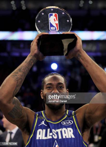 Kawhi Leonard of Team LeBron celebrates with the trophy after being named the Kobe Bryant MVP during the 69th NBA AllStar Game at the United Center...
