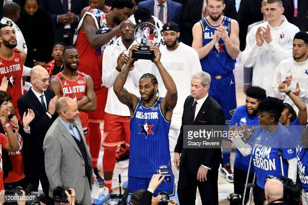 Kawhi Leonard of Team LeBron celebrates with the trophy after being named the Kobe Bryant MVP during the 69th NBA All-Star Game at the United Center...