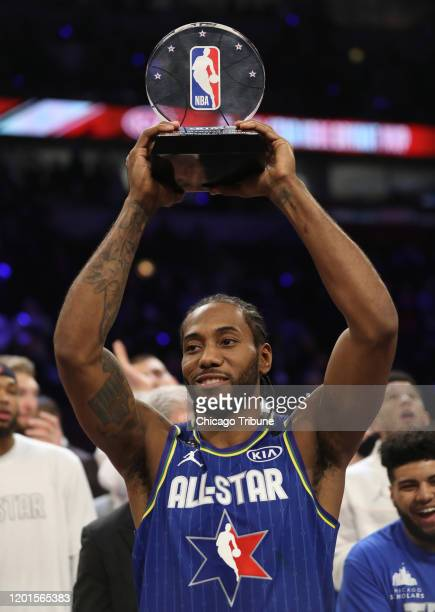 Kawhi Leonard of Team LeBron hoists the NBA All-Star Game Kobe Bryant MVP Award following the NBA All-Star Game on Sunday, Feb. 16, 2020 at the...