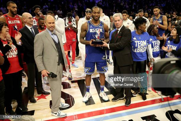 Kawhi Leonard of Team LeBron receives the trophy after being named the Kobe Bryant MVP during the 69th NBA All-Star Game at the United Center on...