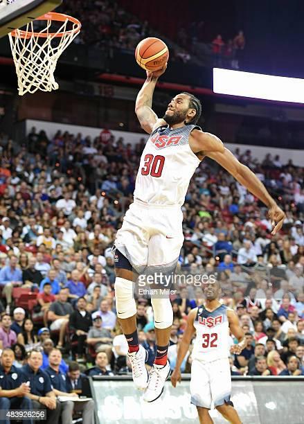 Kawhi Leonard of the 2015 USA Basketball Men's National Team dunks as teammate Arron Afflalo looks on during a USA Basketball showcase at the Thomas...