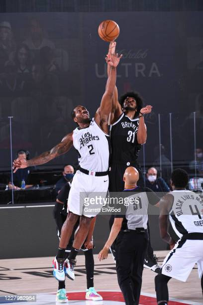 Kawhi Leonard of the LA Clippers and Jarrett Allen of the Brooklyn Nets jump for the ball during the game on August 9 2020 at AdventHealth Arena in...