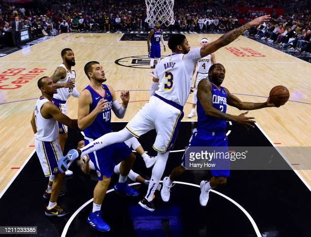 Kawhi Leonard of the LA Clippers attempts a shot in front of Anthony Davis of the Los Angeles Lakers during a 112103 Lakers win at Staples Center on...