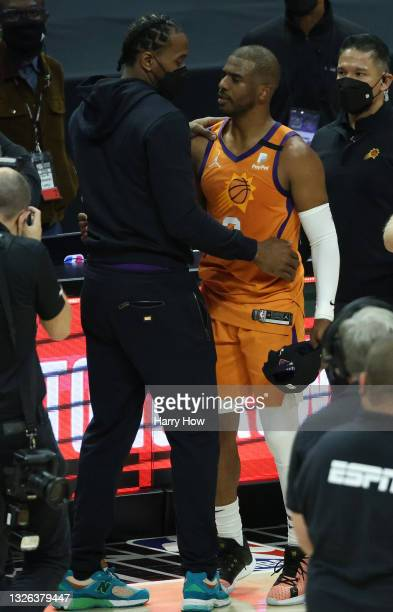 Kawhi Leonard of the LA Clippers congratulates Chris Paul of the Phoenix Suns following the Sun's series win against the Clippers in Game Six of the...