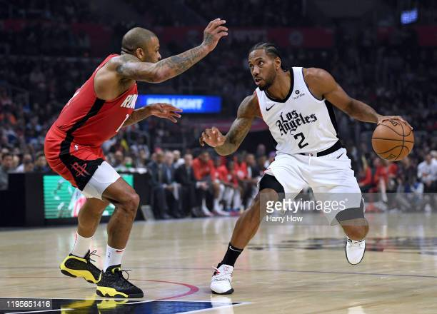 Kawhi Leonard of the LA Clippers dribbles on PJ Tucker of the Houston Rockets during a 122-117 Rockets win at Staples Center on December 19, 2019 in...