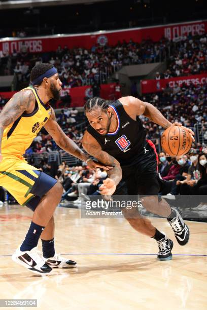 Kawhi Leonard of the LA Clippers dribbles the ball during Round 2, Game 4 of 2021 NBA Playoffs on June 14, 2021 at STAPLES Center in Los Angeles,...