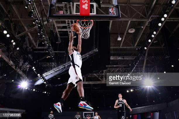 Kawhi Leonard of the LA Clippers drives to the basket against the Brooklyn Nets on August 9 2020 at AdventHealth Arena in Orlando Florida NOTE TO...