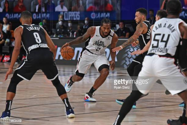 Kawhi Leonard of the LA Clippers drives to the basket against the Brooklyn Nets on August 9 2020 in Orlando Florida at AdventHealth Arena NOTE TO...