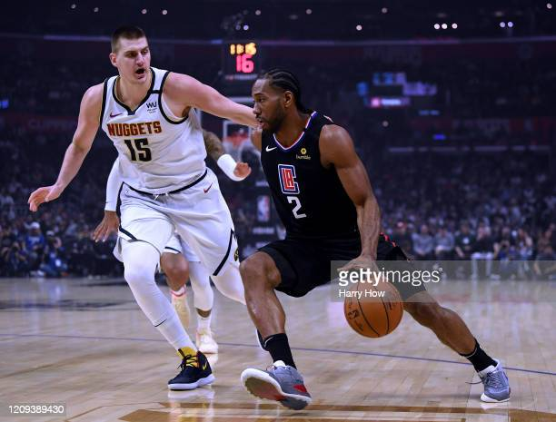 Kawhi Leonard of the LA Clippers drives to the basket on Nikola Jokic of the Denver Nuggets during the first half at Staples Center on February 28,...