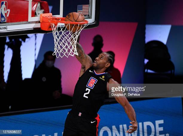 Kawhi Leonard of the LA Clippers dunks the ball during the second quarter against the Denver Nuggets in Game One of the Western Conference Second...