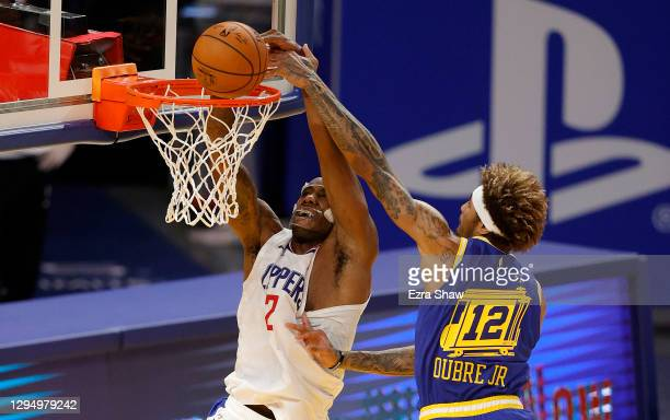 Kawhi Leonard of the LA Clippers goes up for a dunk on Kelly Oubre Jr. #12 of the Golden State Warriors at Chase Center on January 06, 2021 in San...
