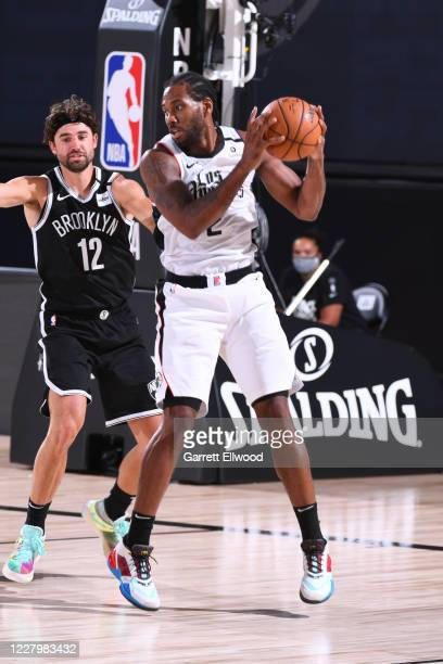 Kawhi Leonard of the LA Clippers handles the ball against the Brooklyn Nets on August 9 2020 at AdventHealth Arena in Orlando Florida NOTE TO USER...