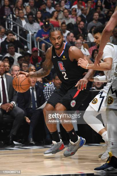 Kawhi Leonard of the LA Clippers handles the ball against the Denver Nuggets on February 28 2020 at STAPLES Center in Los Angeles California NOTE TO...