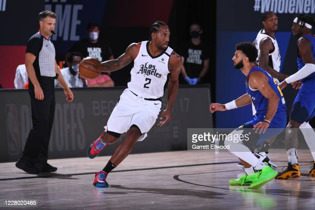 Kawhi Leonard of the LA Clippers handles the ball against the Denver Nuggets on August 12 2020 at the AdventHealth Arena at in Orlando Florida NOTE...